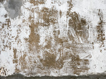 weathered paint on concrete surface