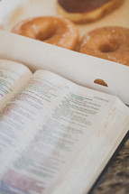 Bible and donuts