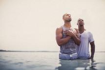 Baptism in the ocean water.