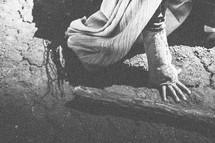 Paul's hand on soil