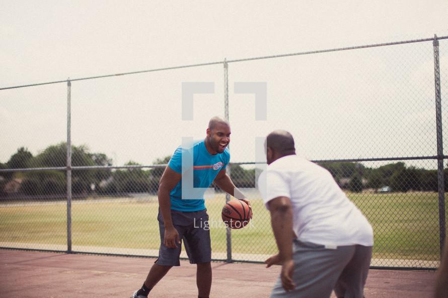 Men playing basketball.