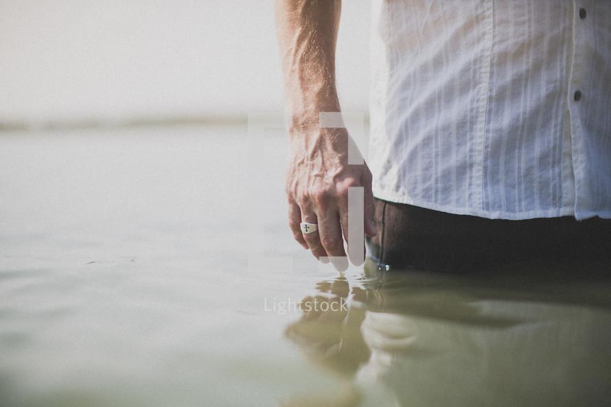 Man standing in the ocean water.
