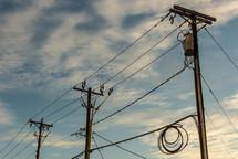 power lines against a blue sky