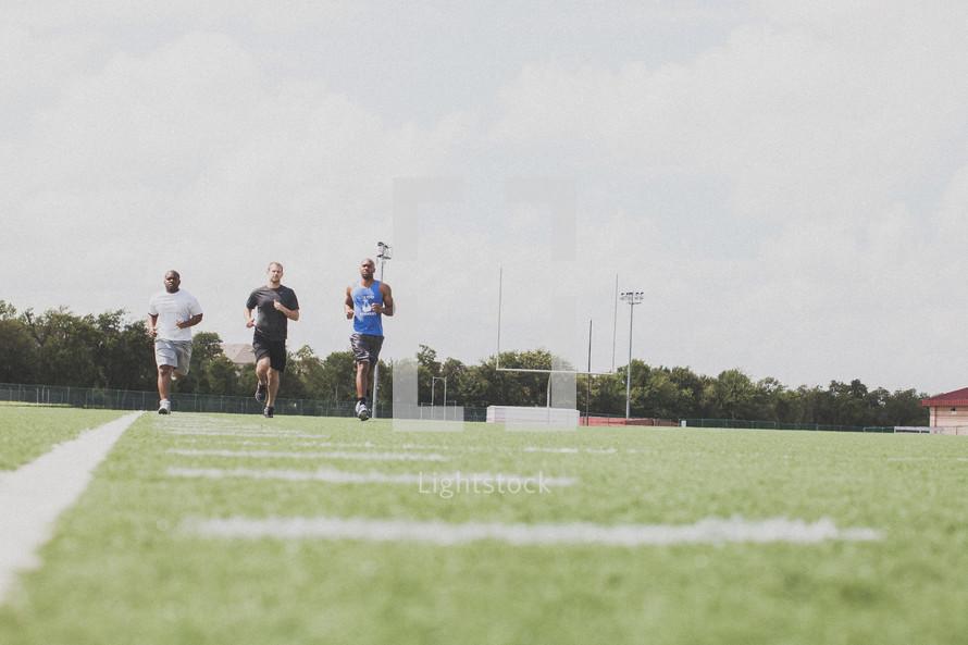 men running at football practice