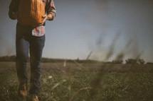 man carrying a pumpkin