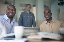 men smiling at a small group Bible study