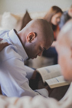 group prayer at a Bible study