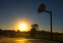 sunset and a basketball goal