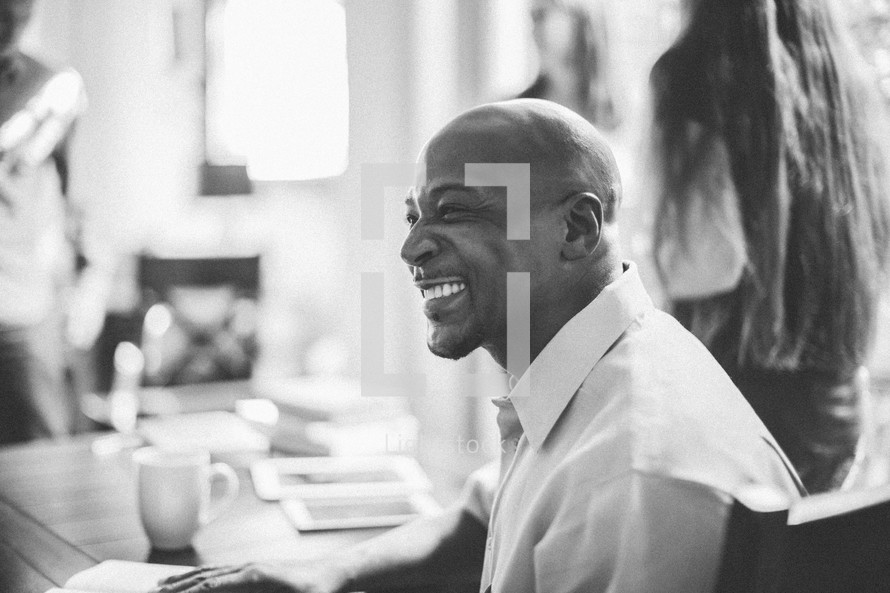 smiling man at a Bible study