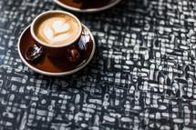 heart shaped creamer in coffee