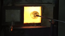 the art of glass blowing, glass in a furnace