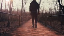 man walking along a path