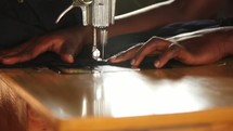 a woman on a sewing machine in Uganda