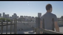 man walking on a rooftop