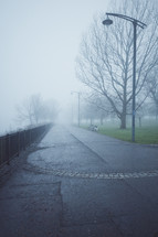 foggy paved path in a park in Glasgow