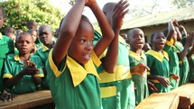 school children clapping and singing