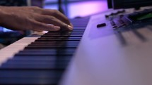 hands playing a keyboard