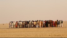 men and women gathering in the desert