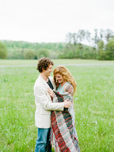 couple in love in a grass field