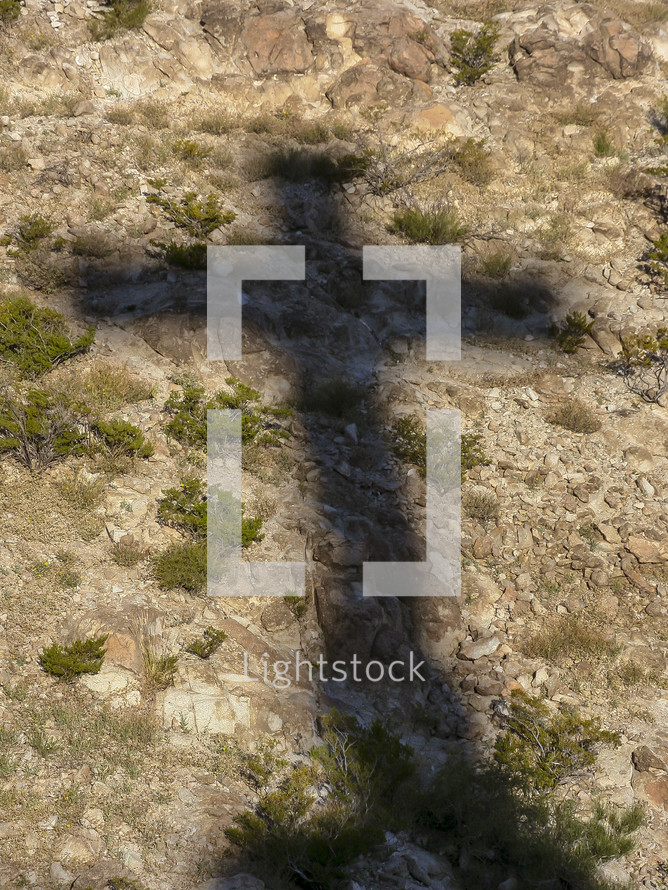shadow of a cross on the ground