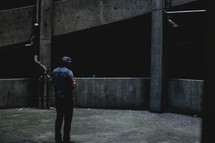 man standing alone in abandoned building