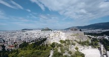 drone flying over an ancient Greek city
