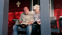 a husband and wife read a Bible together