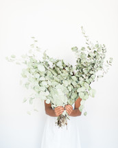 girl holding eucalyptus
