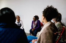 a small group of women in a discussion