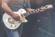 lead electric guitar worship team member at practice