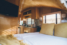 bed and kitchen in a camper
