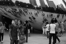 couple taking a photograph together in front of iconic sculpture in Chicago