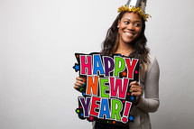 A woman holding a Happy New Year sign.