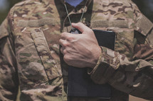 serviceman holding a Bible over his heart