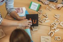 children playing with alphabet blocks