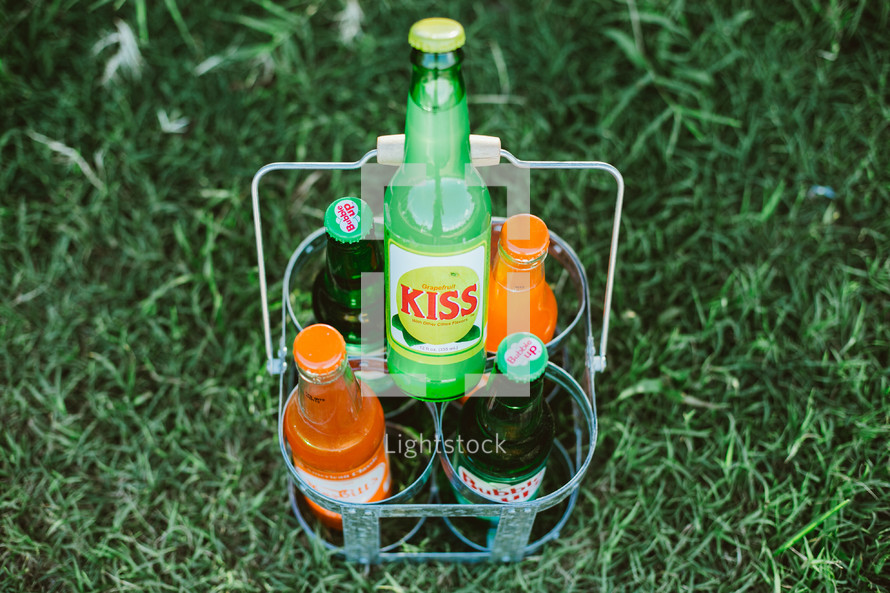 sodas in the grass