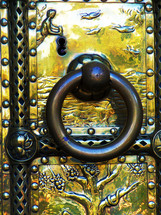 brass door and door knocker with the story of creation . A large brass door and door knocker with the story of creation  embedded into each panel to tell  the story of Genesis and  the six days of creation. This is a beautiful brass work with much detail and history embedded in each panel of the door.