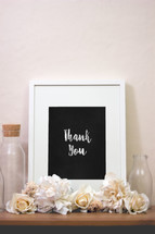 words thank you in a frame