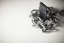 Chain wrapped around a cell phone.
