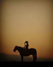 silhouette of a cowboy on his horse