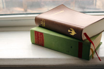 Bibles on a window sill