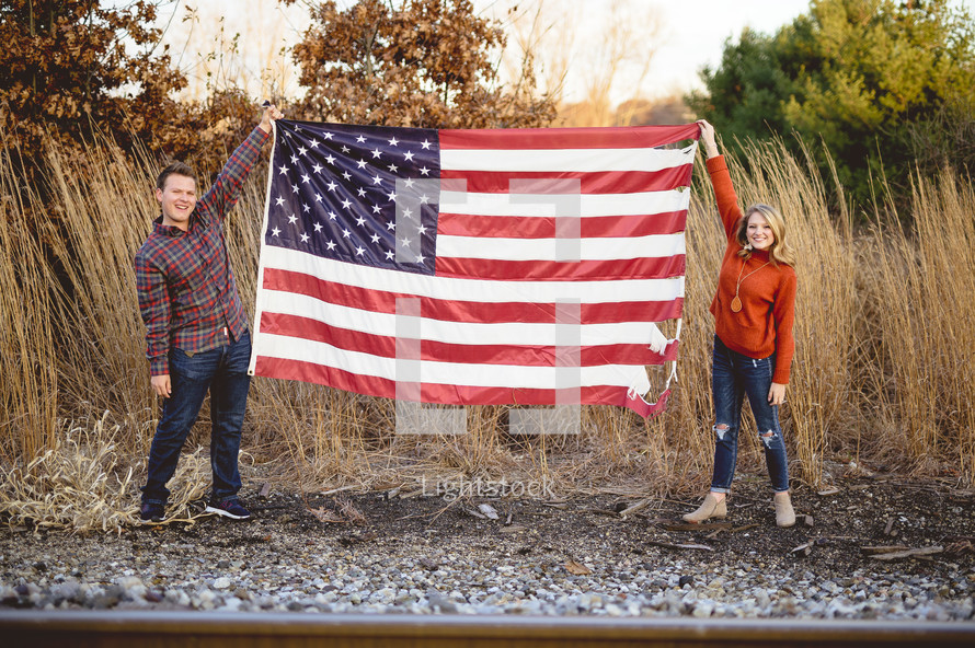 couple holding up an American flag