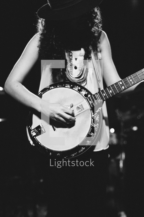 person playing a banjo