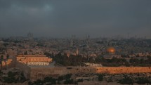 This is an early morning time-lapse of the sun rising over the Old City of Jerusalem. Vantage point is from the Mount of Olives.