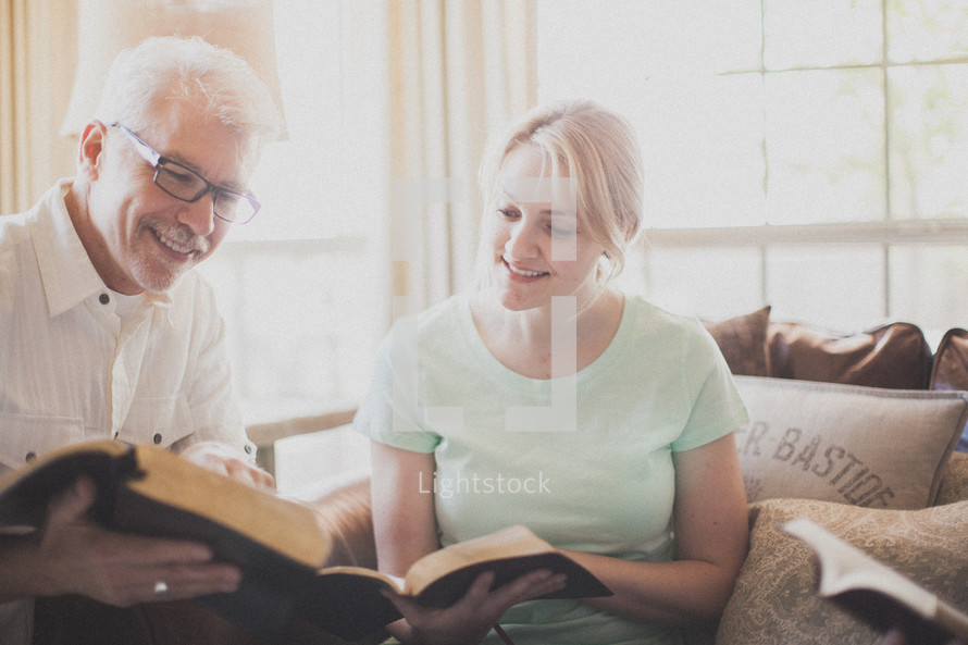 man and woman at a Bible study