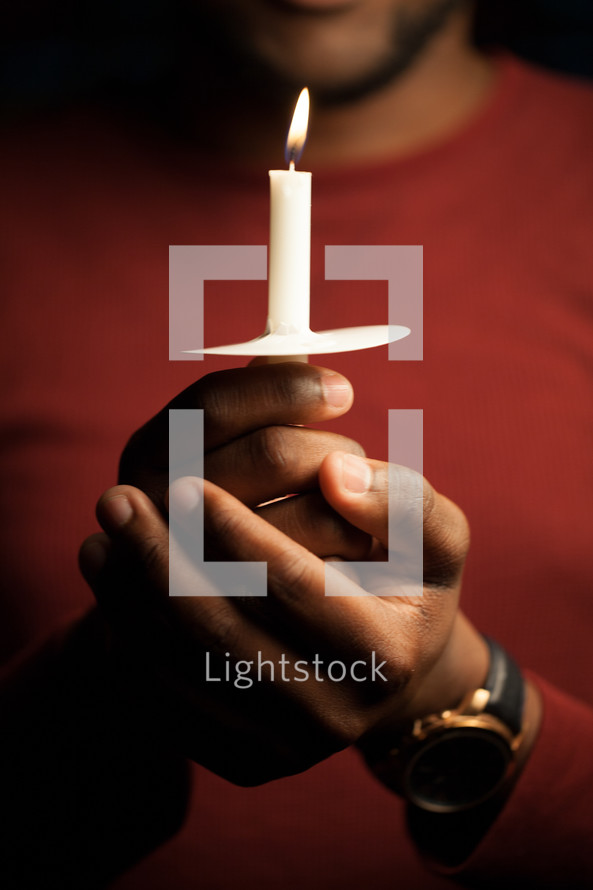 man, African American, holding, candle, Christmas Eve, Candlelight service, worship service