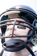 football player with John 3;16 on his face