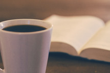 coffee mug and open Bible