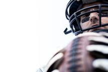 football player holding a football