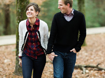 couple walking together holding hands